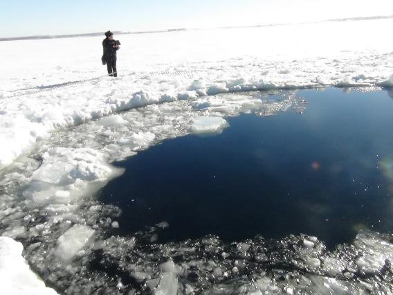 End of the line: a crater in a frozen lake. Credit:  ITAR-TASS Itar-Tass Photos/Newscom.