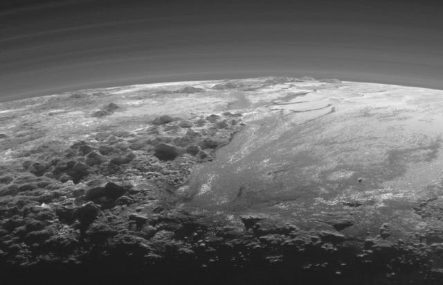Horizon of Pluto with Norgay Montes (left) and Sputnik Planum (right). Credit: NASA/Johns Hopkins University/Southwest Research Institute.