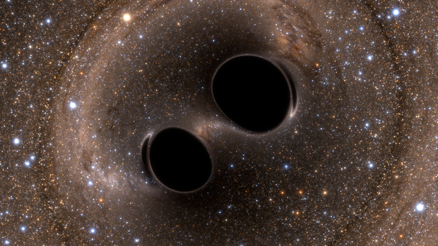 Computer-generated image of two black holes in the process of merging. Credit: the LIGO Collaboration.